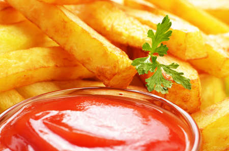 deep fry: French fries with ketchup closeup view