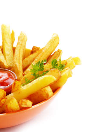 French fries with ketchup over white