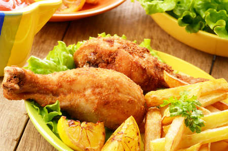 french fries plate: Fried chicken with french fries on the table