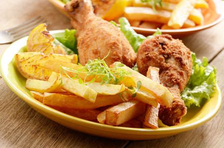 Fried chicken with french fries on the table photo