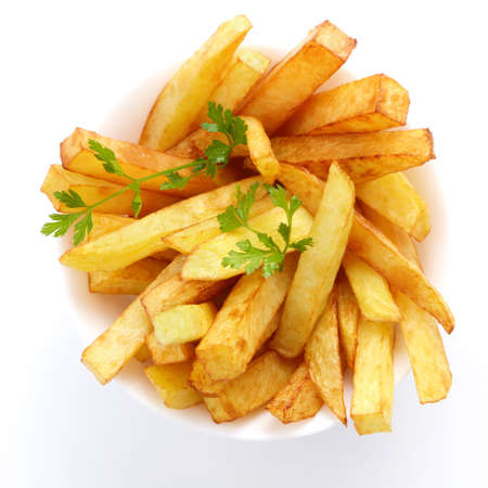 Dish with french fries over white background