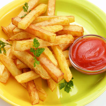 fried snack: French fries with ketchup over white background