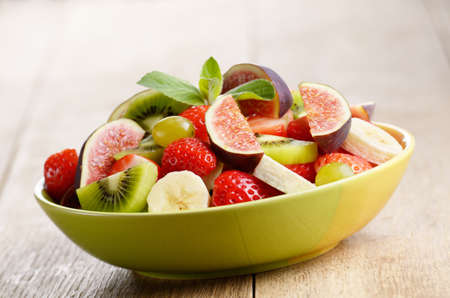 fruits background: Healthy fruit mix salad on the kitchen table