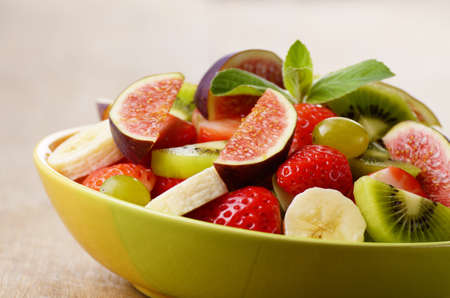 fruit mix: Healthy fruit mix salad on the kitchen table