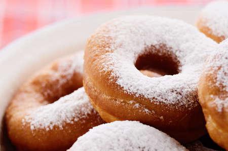 crusty: Powdered sugar crusty donuts closeup