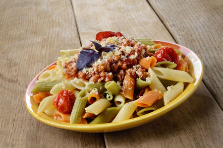 Pasta penne with bolognese tomato beef sauce on the kitchen table Stock Photo