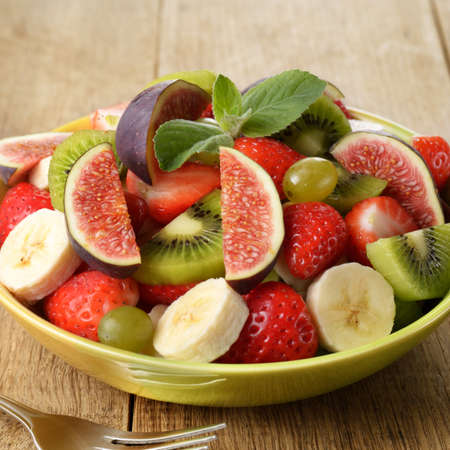 Healthy fruit mix salad on the kitchen table Stock Photo - 16814649