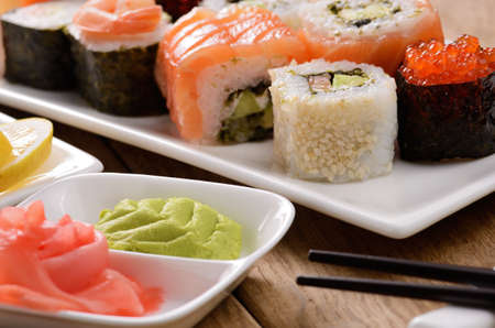 Mixed sushi on a white plate with soy sauce wasabi and ginger Stock Photo - 17084749