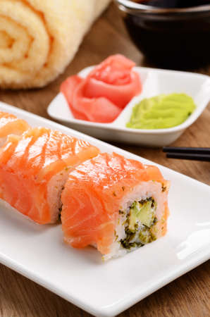 Philadelphia roll sushi on a white plate with soy sauce wasabi and ginger Stock Photo - 17084751