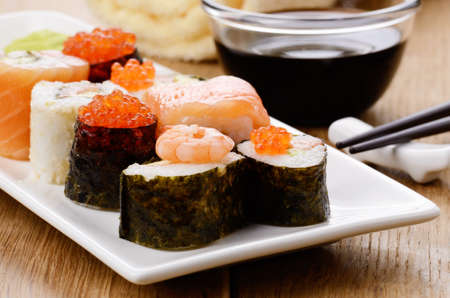 Mixed sushi on a white plate with soy sauce wasabi and ginger Stock Photo - 17084750