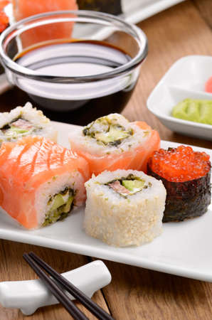 Mixed sushi on a white plate with soy sauce wasabi and ginger Stock Photo - 17191746