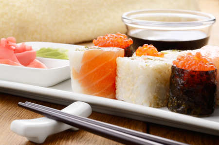 Mixed sushi on a white plate with soy sauce wasabi and ginger Stock Photo - 17191736