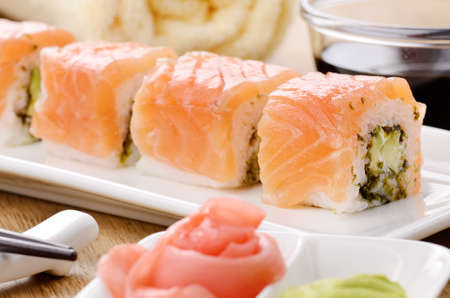 Philadelphia roll sushi on a white plate with soy sauce wasabi and ginger Stock Photo - 17563367