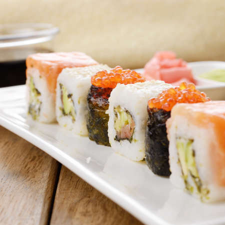 Mixed sushi on a white plate with soy sauce wasabi and ginger Stock Photo - 17563364