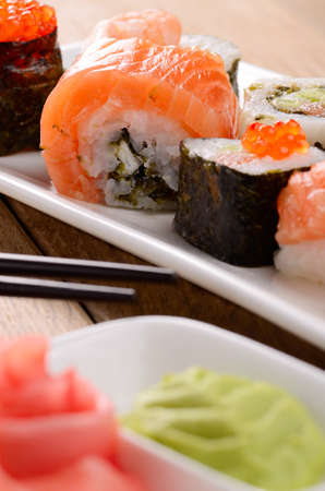 Mixed sushi on a white plate with soy sauce wasabi and ginger Stock Photo - 17563373