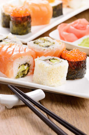 Mixed sushi on a white plate with soy sauce wasabi and ginger Stock Photo - 17563370