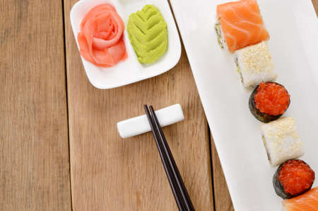 Mixed sushi on a white plate with soy sauce wasabi and ginger Stock Photo - 17563378