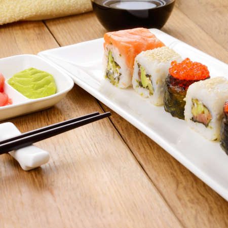 Mixed sushi on a white plate with soy sauce wasabi and ginger Stock Photo - 17684442