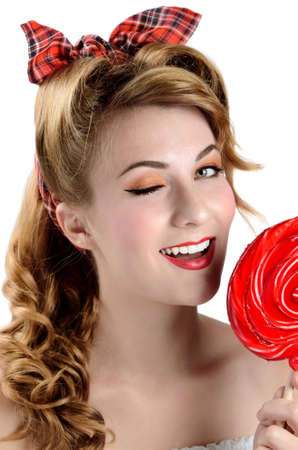 Woman with big red  lollipop candy over white background photo