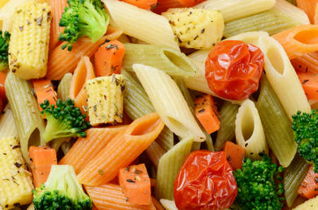 Pasta salad made of penne and vegetables photo