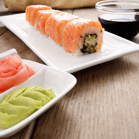 Philadelphia roll sushi on a white plate with soy sauce wasabi and ginger Stock Photo - 18570837