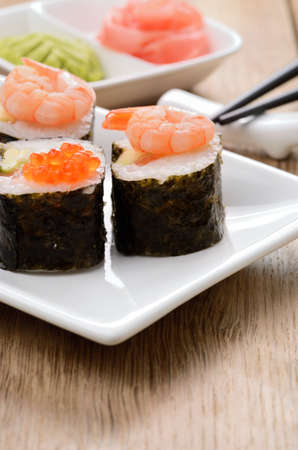 Mixed sushi set on a white plate with wasabi and ginger Stock Photo - 18570840