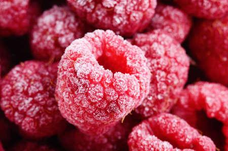 Red frozen raspberries background