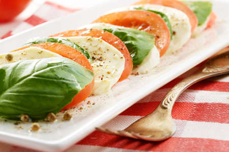 Classic salad caprese on white plate photo