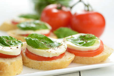 Caprese bruschettas of toast mozzarella tomato and basil photo