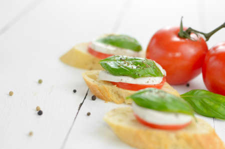 Caprese sandwiches of mozzarella tomato and basil photo