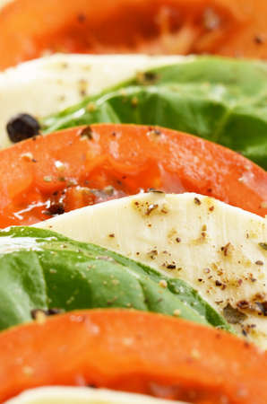 Classic salad caprese of mozzarella tomato and basil photo