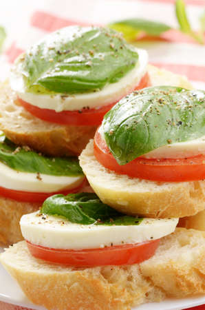 Caprese sandwiches of mozzarella tomato and basil closeup