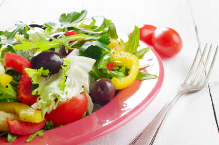 Healthy vegetable fresh organic salad on the white table photo