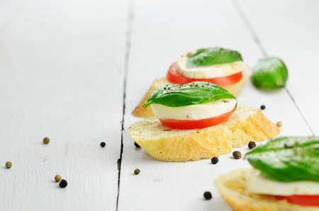 Caprese sandwiches of mozzarella tomato and basil photo
