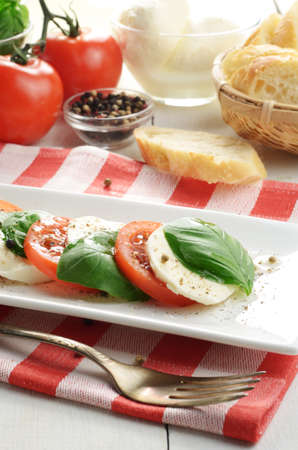 Classic caprese salad on the kitchen table photo
