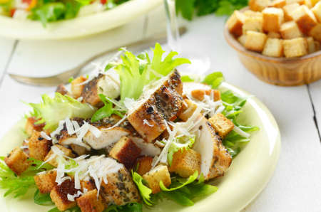 Caesar chicken salad with grated parmesan on white table Stock Photo - 29229429