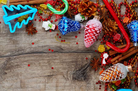 Christmas wooden table frame with baubles spices and candies photo