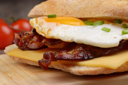 breakfast eggs: Fried egg sandwich with bacon and cheese