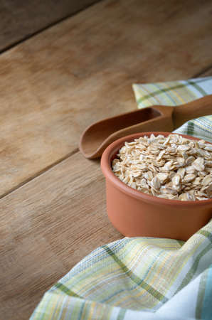 copyspace: Rolled oat groats on the kitchen table with copy-space Stock Photo