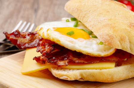 Fried egg sandwich with bacon and cheese