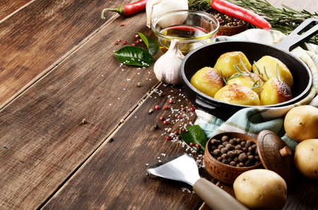 appetising: Pan of Boiled and baked potatoes with herbs vegetables and salt