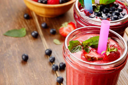 appetising: Blueberry and strawberry mix smoothie on the table