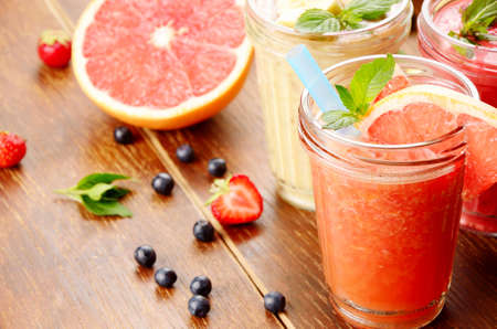 mouth watering: Grapefruit strawberry and banana mix smoothie on the table