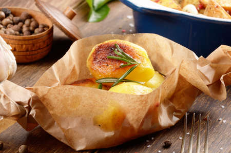appetising: Boiled and baked potatoes with herbs and salt in paper Stock Photo