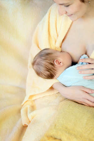 nude little girls: Mother breastfeeding her baby. Healthy lifestyle concept.