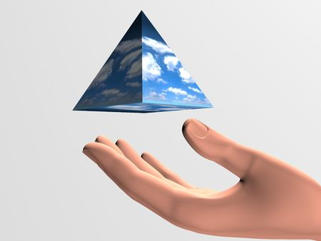 pyramid floating over a human hand  Stock Photo - 5375535