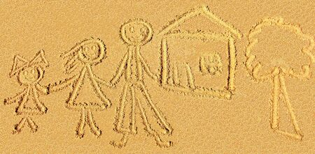 childish sand drawing of the family on the beach