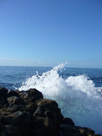 surge: splash of the ocean waves meeting coastal rocks