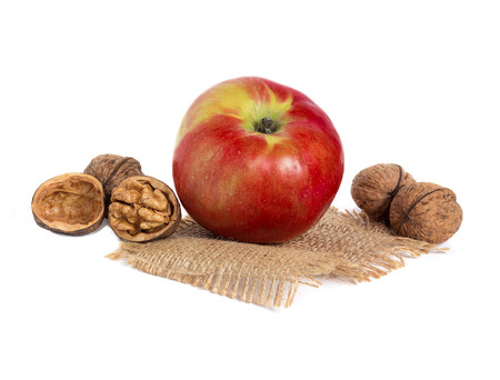 Apple and walnuts isolated on white photo