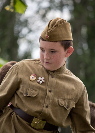 Makeevka, Ukraine - May, 9, 2012: Boy - participant of the historical parade in honor of the anniversary of the victory over fascism